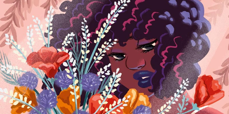 black woman gazing at a bouquet of flowers