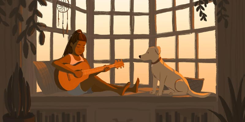 young black girl playing guitar with her dog